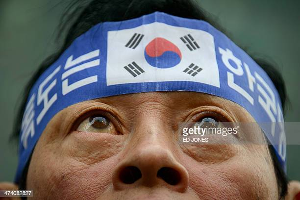 'Dokdo is Korean territory' during a protest over the disputed Dokdo islands in front of the Japanese Embassy in Seoul on February 22 2014 Japan is...