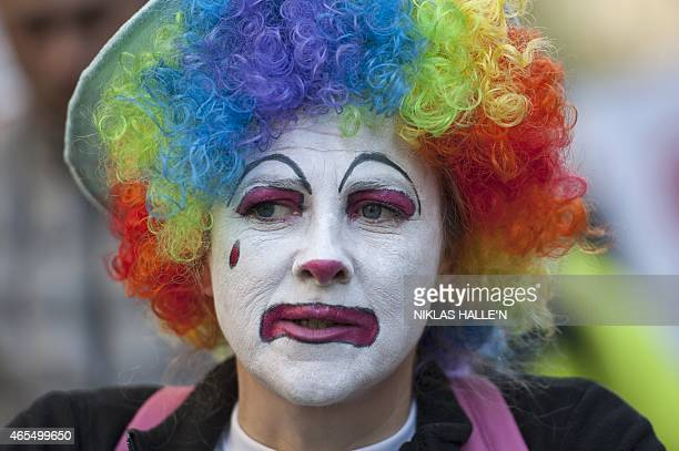 A demonstrator wears a coloured wig and facial paint as she takes part in The People's Climate march in central London on March 7 2015 Around 5000...