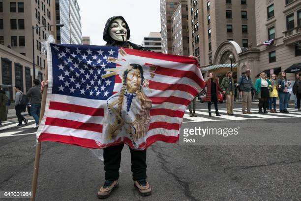 A demonstrator wears a Guy Fawkes mask during the Women's march in Washington This mask is a stylized depiction of Guy Fawkes the Gunpowder plot's...