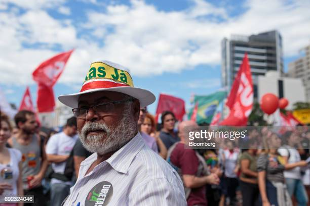 A demonstrator wears a hat that reads 'Direct Elections Now' during a protest against Brazilian President Michel Temer and government corruption at...