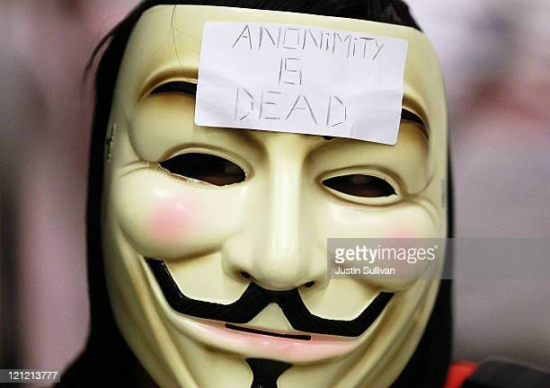 A demonstrator wears a mask during a protest inside the Bay Area Rapid Transit Civic Center station on August 15 2011 in San Francisco California The...