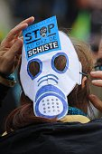 A demonstrator wears a paper gas mask reading 'stop schale gas' on February 28 2016 in Barjac southern France during a protest against shale gas...