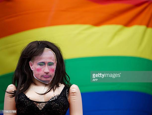 A demonstrator wears a tshirt with a picture of a rouged Vladimir Putin as he takes part in a protest against the new Russian law on homosexuality in...