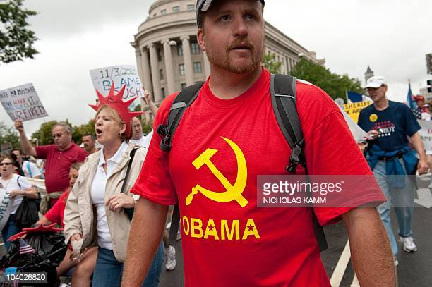 A demonstrator wears a Tshirt with the Communist hammer and sickle symbol and the name of US President Barack Obama during a march by supporters of...