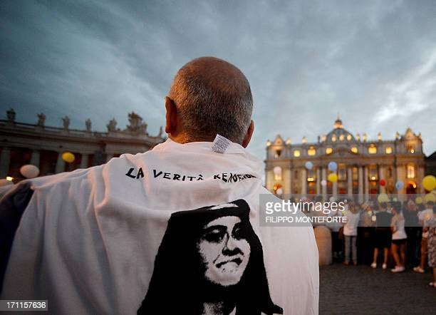 A demonstrator wears a tshirt with the face of Emanuela Orlandi during a commemoration of the 30th anniversary of her disappearance in St Peter's...