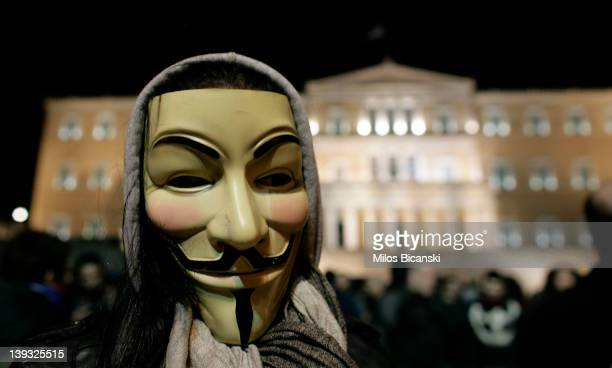 A demonstrator wears an 'anonymous mask' during a protest against austerity measures in front of Parliament on February 19 2012 in Athens Greece...