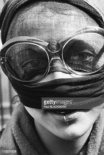A demonstrator wears glasses and a scarf to protect against tear gas during protests against the 27th Group of Eight Summit in July 2001 in Genoa...