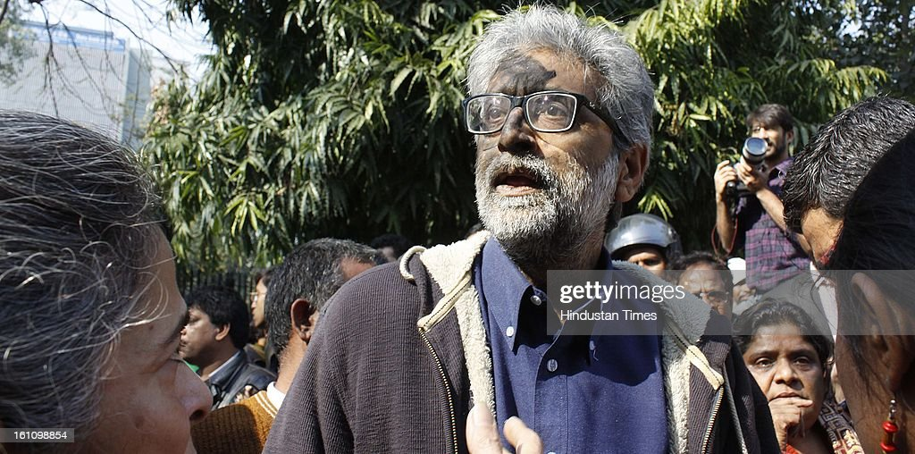 - A demonstrator, who was defaced with black ink by Hindu hardliners, shouts slogans during a protest to condemn the hanging of Mohammad Afzal Guru on February 9, 2013 in New Delhi, India. Guru, who was found guilty of conspiring and sheltering the militants who attacked Parliament on December 13, 2001 in which nine people were killed, was buried in the prison premises as per the jail manual.