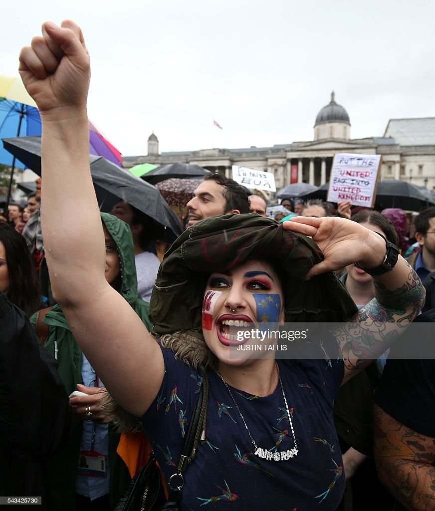 A demonstrator with a European flag painted on her face chants at an anti-Brexit protest in Trafalgar Square in central London on June 28, 2016. EU leaders attempted to rescue the European project and Prime Minister David Cameron sought to calm fears over Britain's vote to leave the bloc as ratings agencies downgraded the country. Britain has been pitched into uncertainty by the June 23 referendum result, with Cameron announcing his resignation, the economy facing a string of shocks and Scotland making a fresh threat to break away. / AFP / JUSTIN