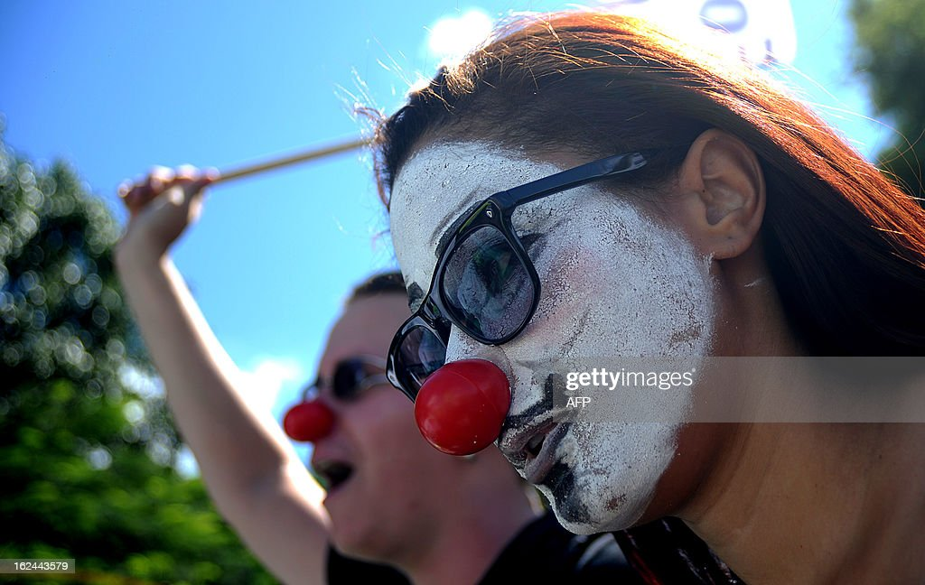 A demonstrator with her face painted as a Guy Fawkes mask takes part in a protest against the president of the Brazilian Senate, Renan Calheiros, in front of the Brazilian National Congress, in Brasilia, on February 23, 2013. Calheiros was elected by his colleagues despite many corruption claims over him. An undersigned made on the internet with over then 1,5 million signatures was delivered by activists to the Senate this week, demanding his impeachment. AFP PHOTO/PEDRO LADEIRA