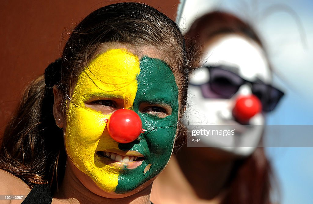 A demonstrator with her face painted takes part in a protest against the president of the Brazilian Senate, Renan Calheiros, in front of the Brazilian National Congress, in Brasilia, on February 23, 2013. Calheiros was elected by his colleagues despite many corruption claims over him. An undersigned made on the internet with over then 1,5 million signatures was delivered by activists to the Senate this week, demanding his impeachment.