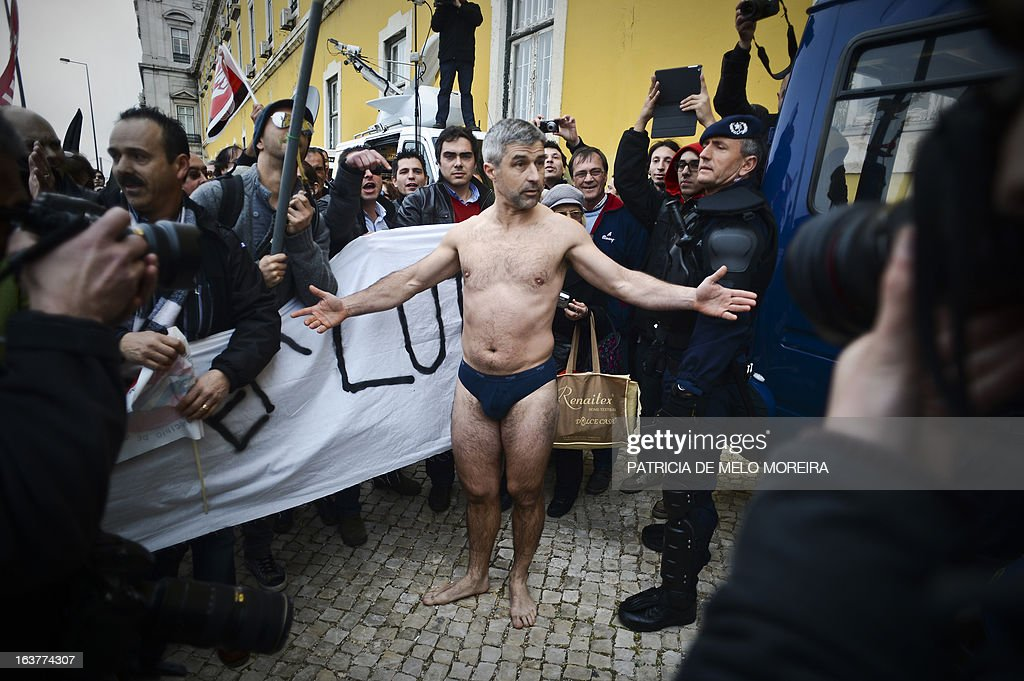 A demonstrator with only underwear gestures as he takes part in a demonstration called by the unions Common Front, CGTP (General Confederation of the Portuguese Workers) and STAL (National Union of the Local and Regional Public Workers) against the austerity measures of the Portuguese government in Lisbon on March 15, 2013. Today the Finance Minister, Vitor Gaspar, said that the GDP (Gross Domestic Product) will drop 2.3%, that unemployment might reach 19% and the adjustment effort will have to continue for decades.'