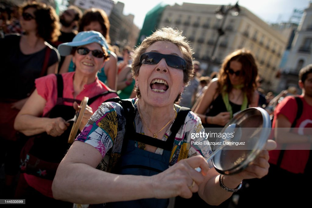 A demonstrator with Spain's Indignant movement shouts and hits a pan lid during a rally at Puerta del Sol on May 15, 2012 in Madrid, Spain. Spain's Indignant movement has prepared events across Spain to mark the first anniversary of their movement, formed to protest against corruption in politics, the economic crisis and the high unemployment rate. The movement's anniversary coincides with Madrid's regional festivities.