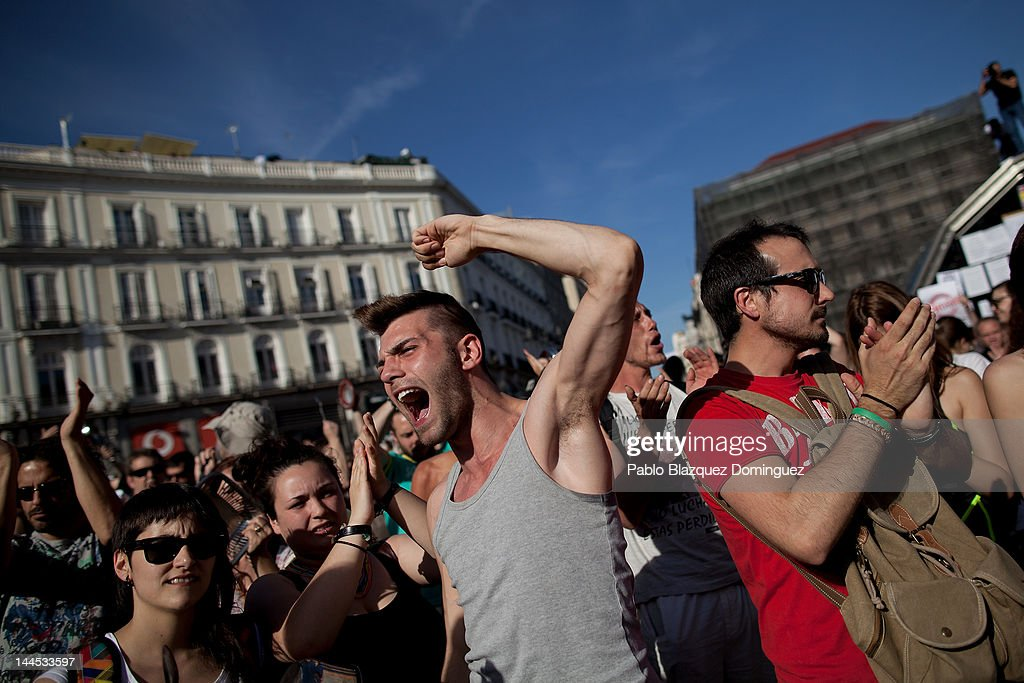 A demonstrator with Spain's Indignant movement shouts during a rally at Puerta del Sol on May 15, 2012 in Madrid, Spain. Spain's Indignant movement has prepared events across Spain to mark the first anniversary of their movement, formed to protest against corruption in politics, the economic crisis and the high unemployment rate. The movement's anniversary coincides with Madrid's regional festivities.