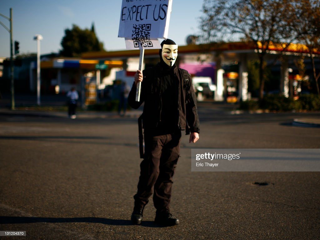 A demonstrator with the Occupy movement marches on the Port of Oakland November 2, 2011 in Oakland, California. Tens of thousands of protestors have marched to the Port of Oakland for a general strike organized by Occupy Oakland. Port operations shut down for the evening.