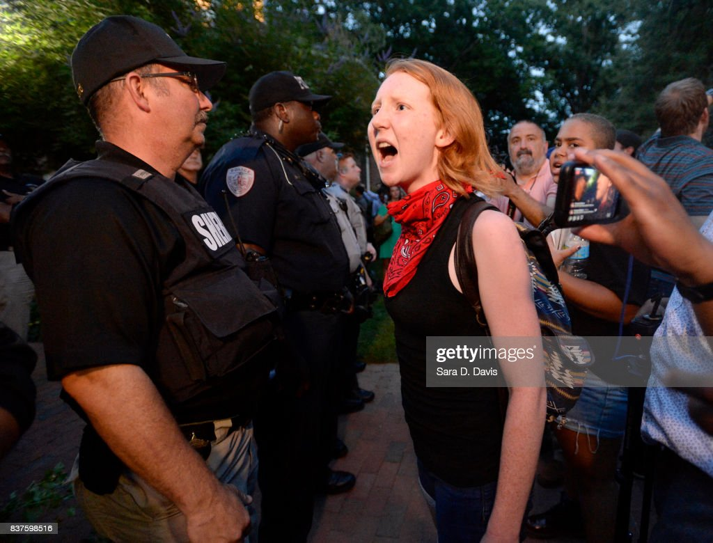A demonstrator yells at a sheriff deputy during a rally for the removal of a Confederate statue, coined Silent Sam, on the campus of the University of Chapel Hill on August 22, 2017 in Chapel Hill North Carolina.