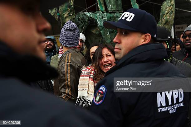 A demonstrator yells at police during a protest outside the Immigration Court in New York City on January 8 2016 in New York City The afternoon...
