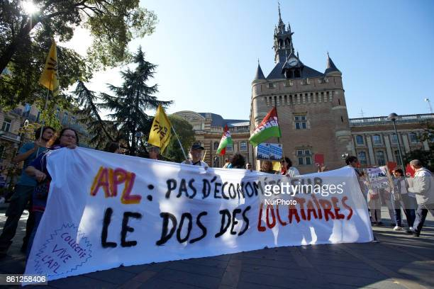 Demonstratoros hold a banner near the Capitole's Donjon reading 'Personnal housing allowance no savings behind tenants's backs' As Macron's...
