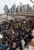 Demonstrators affiliated with the Occupy Wall Street movement attempt to cross the Brooklyn Bridge on on the motorway on October 1 2011 New York City...