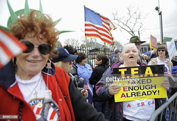 Demonstrators against US President Barack Obama's national tax stage a protest in Staten Island New York April 15 2009 Critics of Obama marked...