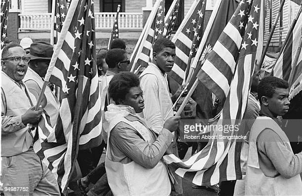 Demonstrators and marchers carry American flags on the Selma to Montgomery march held in support of voter rights Alabama late March 1965