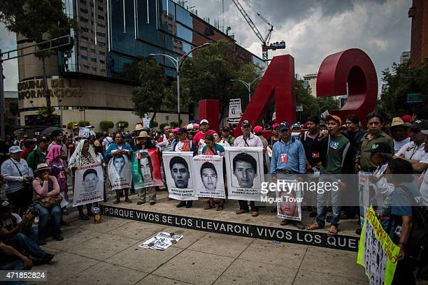 Demonstrators and relatives of the 43 missing students of Ayotzinapa college march during a massive protest rally commemorating Labor Day on May 01...