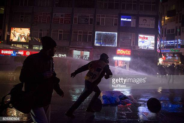 Demonstrators are sprayed by water cannons during a protest on February 25 2014 against corruption following the release of tapped phone conversation...