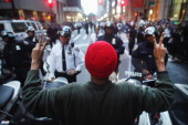 Demonstrators associated with the 'Occupy Wall Street' movement face off with police in the streets of the financial district after the deadline for...