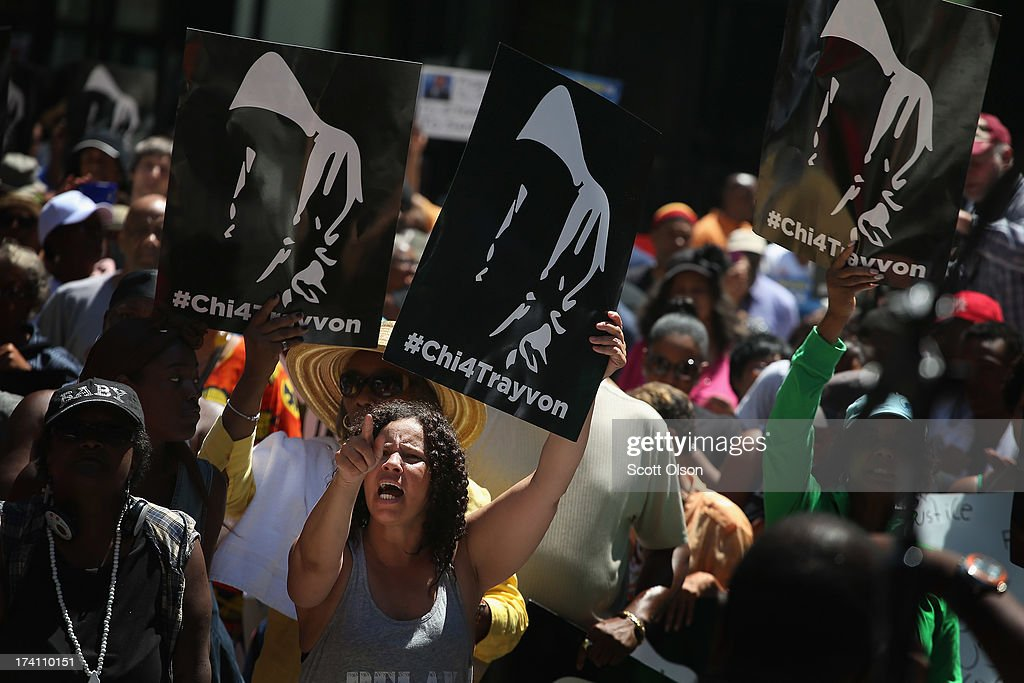 Demonstrators attend a 'Justice For Trayvon' rally at Federal Plaza in the Loop July 20, 2013 in Chicago, Illinois. The rally was one of a scheduled 100 to be held in cities across the country today to protest a Florida jury's decision last week to find neighborhood watch volunteer George Zimmerman not guilty of murder in the February 2012 shooting death of Trayvon Martin.