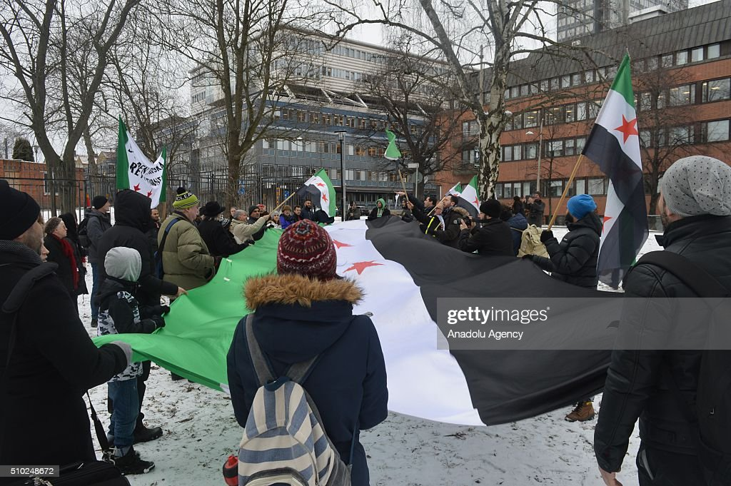 Demonstrators attend a protest, organized by Syrian Federation in Sweden and Conservative Social Democratic Union of Sweden, against Russian President Vladimir Putin and Assad Regime, in front of Russian Embassy in Stockholm, Sweden in February 14, 2016.