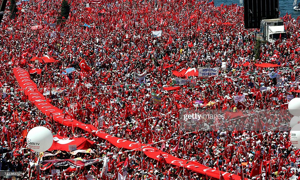 Demonstrators attend a rally in support of secularism in Izmir, western coastal city of Turkey, 13 May 2007. A bomb ripped through a marketplace in Izmir the previous day on the eve of the rally, killing one person and leaving 14 others injured, officials said.