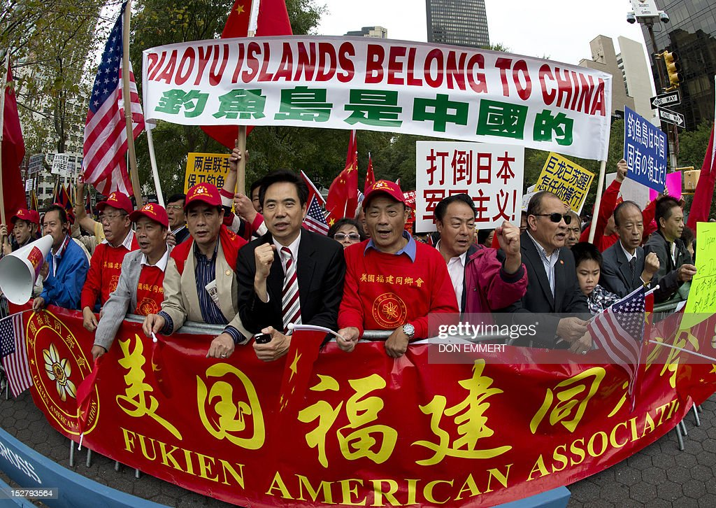 Demonstrators believing that the Diaoyu Islands belong to China protest across the street from the United Nations during the 67th United Nations...