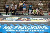 Demonstrators block 1st NE in front of the Federal Energy Regulatory Commission's office to protest fracking policies May 29 2015