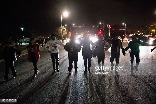 Demonstrators block a downtown intersection on December 11 2015 in Chicago Illinois A recently released video showing the shooting of Laquan McDonald...