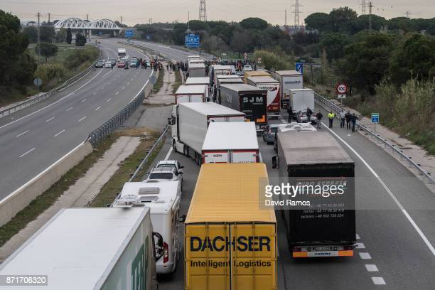 Demonstrators block a highway during a regional strike on November 8 2017 in Riudellots de la Selva Spain ProIndependence Unions and associations...