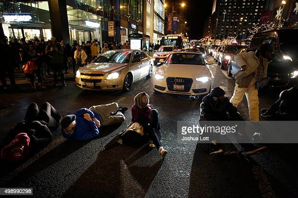 Demonstrators block motorist along Michigan Avenue as they protest the shooting of Laquan McDonald who was killed by a Chicago police officer...