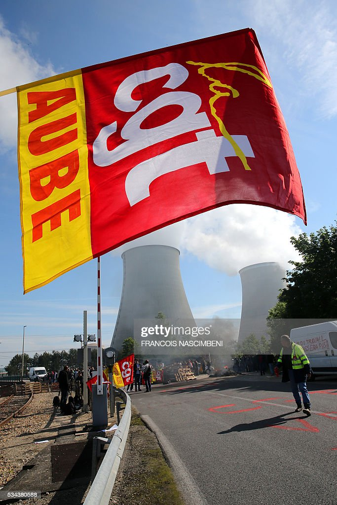 Demonstrators block the access to the nuclear power plant of Nogent-sur-Marne on May 26, 2016, during a protest against controversial labour market reforms that has already severely disrupted fuel supplies. With two weeks until France hosts the Euro 2016 football championships, the country has been paralysed by a series of transport strikes and fuel shortages that has heaped pressure on the deeply unpopular Socialist government. / AFP / FRANCOIS