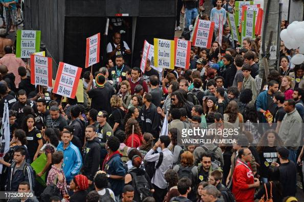 Demonstrators block the Brasil Avenue the main access to Rio de Janeiro in front of the Favelas de Mare complex during a protest against violence by...