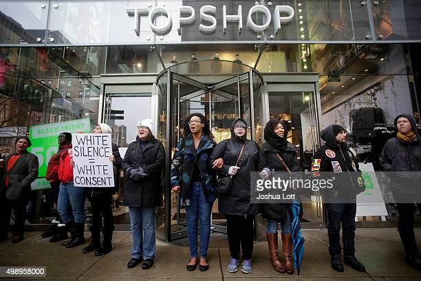 Demonstrators block the entrance of Top Shop as they protest the shooting of Laquan McDonald along the Magnificent Mile November 27 2015 in Chicago...