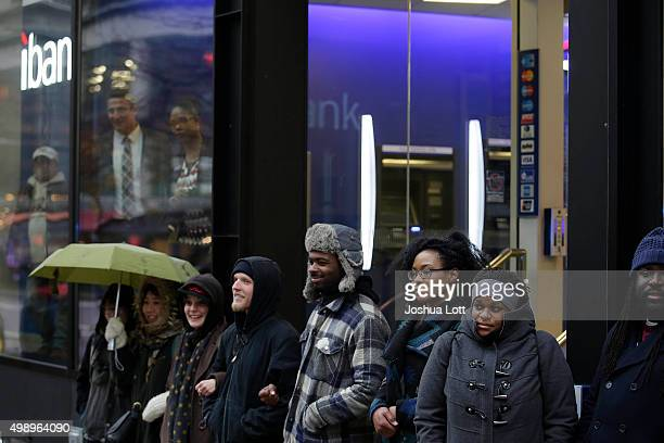 Demonstrators block the entrance to Citibank as they protest the shooting of Laquan McDonald who was killed by a Chicago police Officer along...