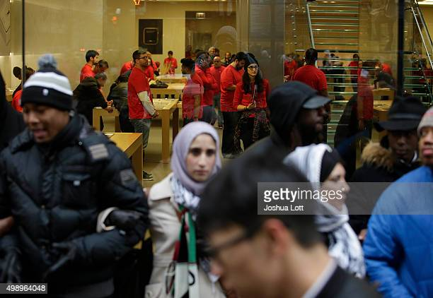 Demonstrators block the entrance to the Apple store as they protest the shooting of Laquan McDonald who was killed by a Chicago police Officer along...