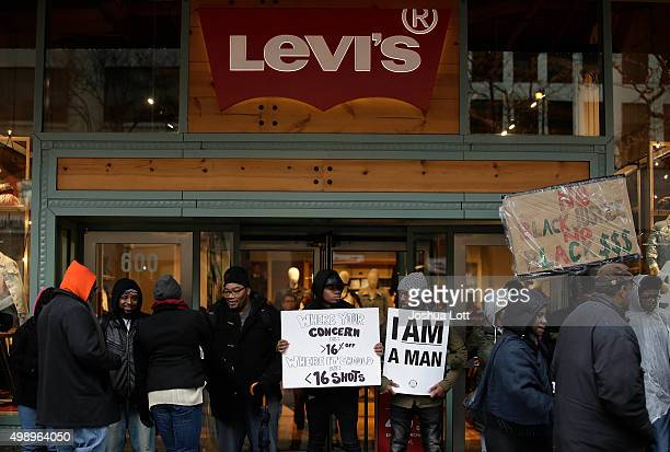 Demonstrators block the entrance to the Levi's store as they protest the shooting of Laquan McDonald who was killed by a Chicago police Officer along...