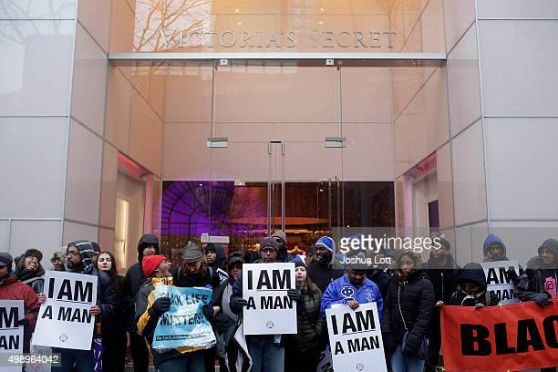 Demonstrators block the entrance to Victoria's Secret as they protest the shooting of Laquan McDonald who was killed by a Chicago police Officer...
