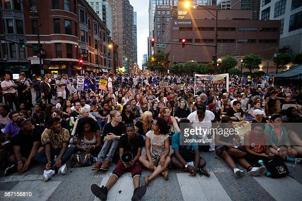 Demonstrators block the intersection of Chicago Avenue and State Street as they protest the fatal police shooting of Paul O'Neal August 7 2016 in...