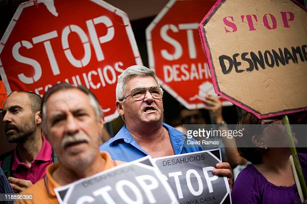 Demonstrators block the main entrance of Angel's building during a demonstration organized by the association 'Affected by the mortgage' to stop the...