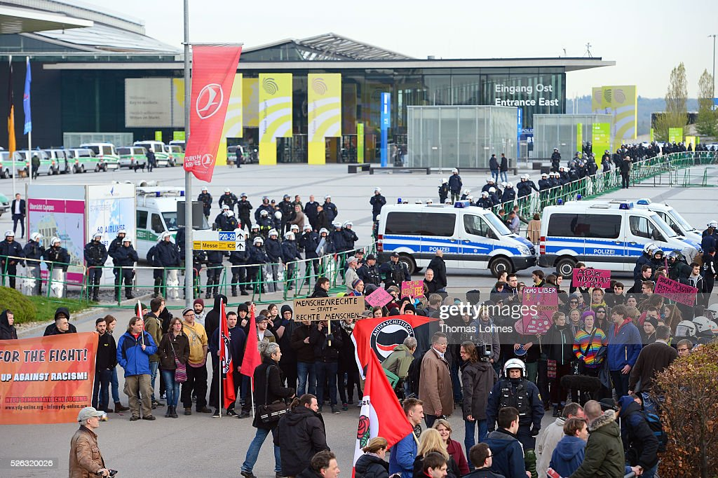 Demonstrators block the way for the AfD delegate to the Alternative fuer Deutschland (AfD) political party federal congress on April 30, 2016 in Stuttgart, Germany. The AfD, a relative newcomer to the German political landscape, has emerged from Euro-sceptic conservatism towards a more right-wing leaning appeal based in large part on opposition to Germany's generous refugees and migrants policy. Since winning seats in March elections in three German state parliaments the party has sharpened its tone, calling for a ban on minarets and claiming that Islam does not belong in Germany.