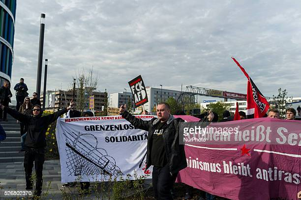 Demonstrators block the way for the AfD delegate to the Alternative fuer Deutschland political party federal congress on April 30 2016 in Stuttgart...