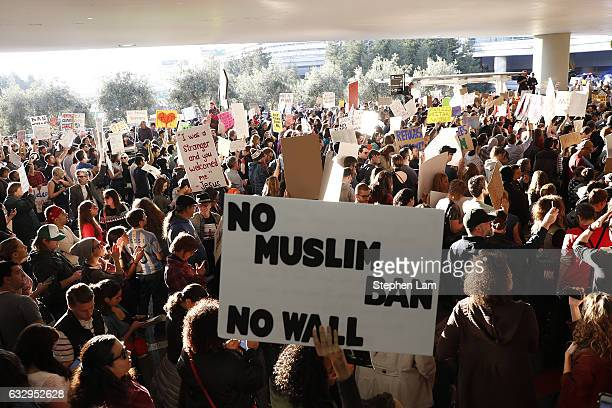Demonstrators block traffic at the international arrival terminal as they protest against muslim immigration ban at San Francisco International...