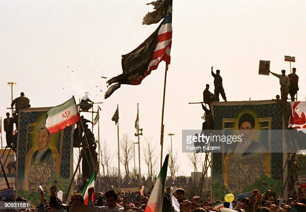 Demonstrators burn a US flag on the twentieth anniversary of the Iranian Revolution Azadi Square Tehran 11th February 1999 The protestors are...