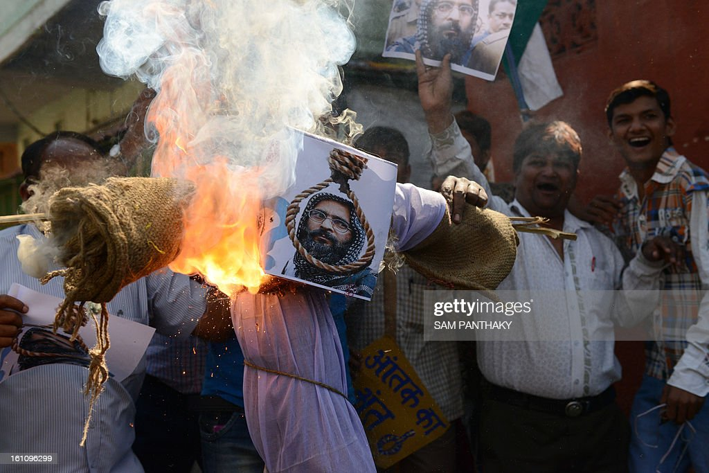 demonstrators burn an effigy of Mohammed Afzal Guru following his execution, in Ahmedabad on February 9, 2013. A Kashmiri separatist was executed Saturday in New Delhi over his role in a deadly attack on parliament in New Delhi in 2001, an episode that brought nuclear-armed India and Pakistan to the brink of war. AFP PHOTO / Sam PANTHAKY